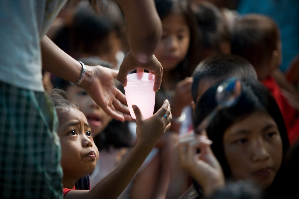 Action International feeding program in squatters area on Manila Bay.